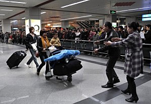 Thousands Of Chinese Return Home Following Evacuation From Japan
