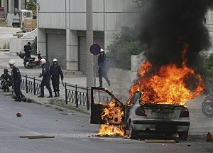 Police Clash With Protestors During Anti-War Demo In Athens