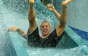 Lewis Moody of England enjoys the waterslide