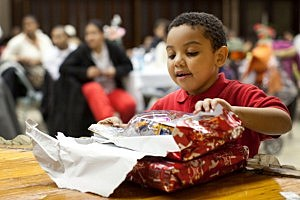 Firefighters Host Christmas Dinner For The Needy In New York City