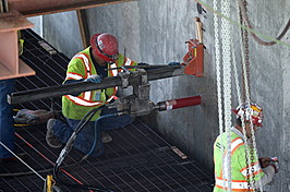 Workers Replace Defective Bolts On Bay Bridge
