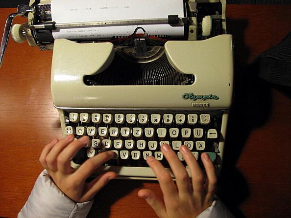 Typing in an old typewriter.