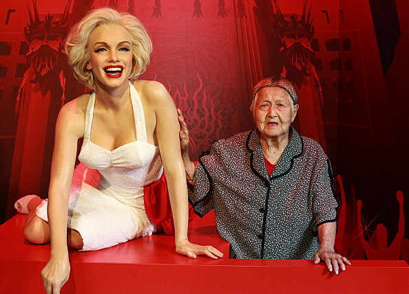 Centenarians Pose With Celebrities' Waxwork For The Double Ninth Festival