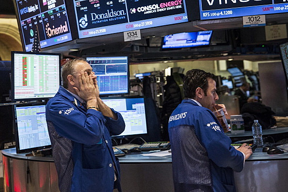 Traders Work On Floor Of NYSE Stock Exchange As New Fed Chief Janet Yellen